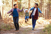 istock Gay Male Couple With Daughter Walking Through Fall Woodland 514319092