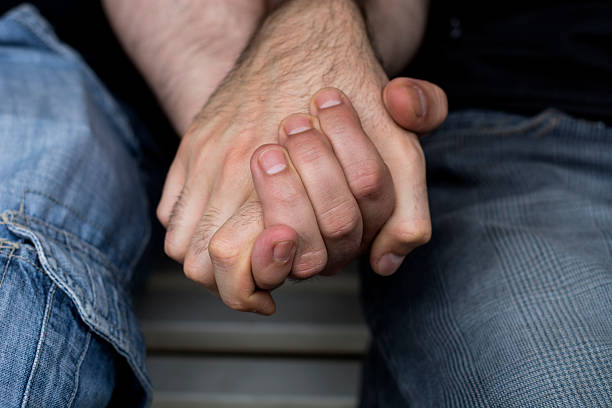 Gay Men Holding Hands Gay Men Holding Hands gay man stock pictures, royalty-free photos & images