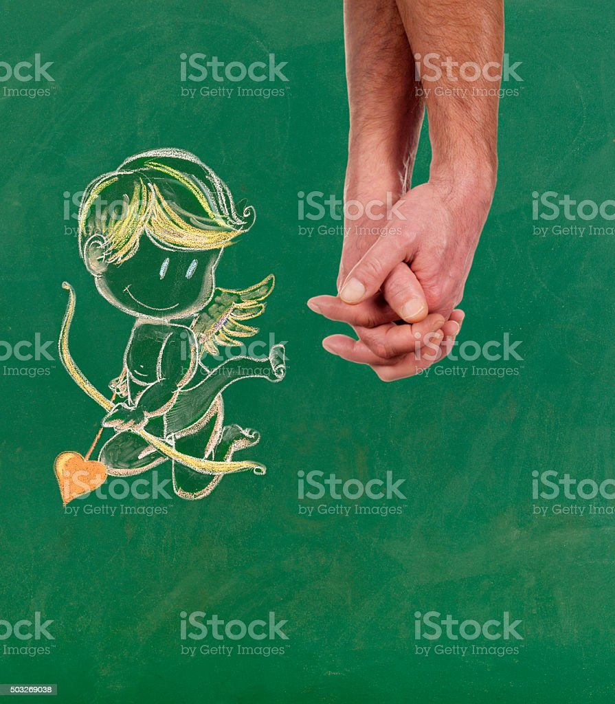 Gay men holding hands with Cupid stock photo