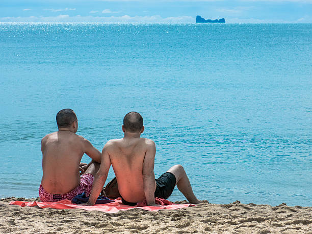 Gay Men LGBT Couple Relaxed Beach Vacation Asia stock photo