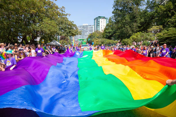 Gay Parade Downtown Vancouver, British Columbia, Canada - August 5, 2018: People celebrating at the Gay Pride Parade. gay pride parade stock pictures, royalty-free photos & images