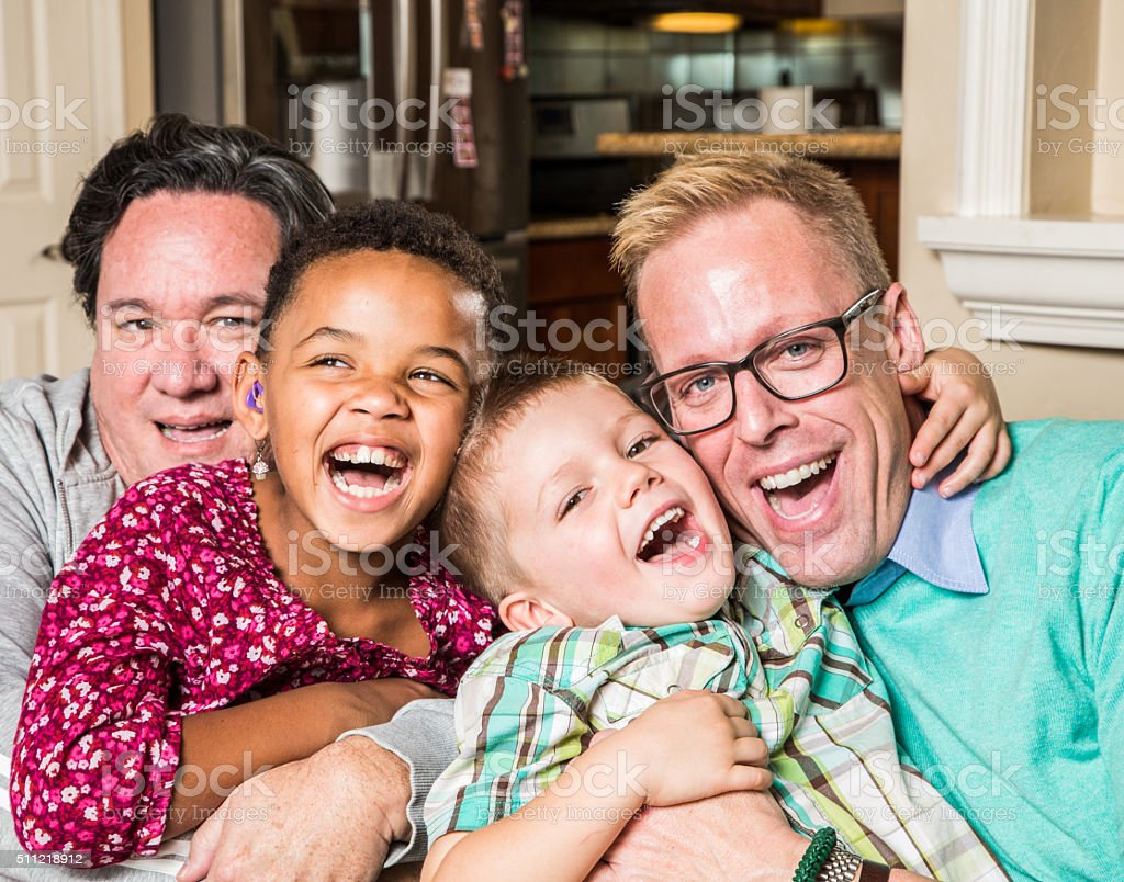 Gay parents with their children stock photo