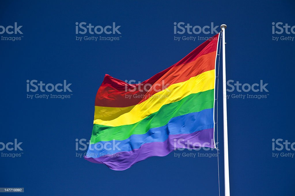 Gay Pride Flag, fluttering in wind stock photo