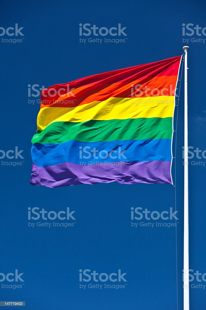 Gay Pride Flag, fluttering in wind royalty-free stock photo