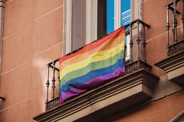 Gay pride flag on building balcony stock photo