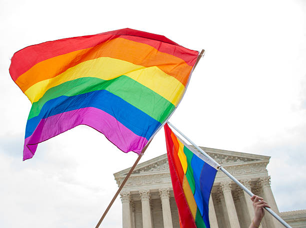 Gay Pride Flags at the U.S. Supreme Court Gay pride flags fly after a landmark decision on same sex marriage by the U.S. Supreme Court lgbtqi rights stock pictures, royalty-free photos & images