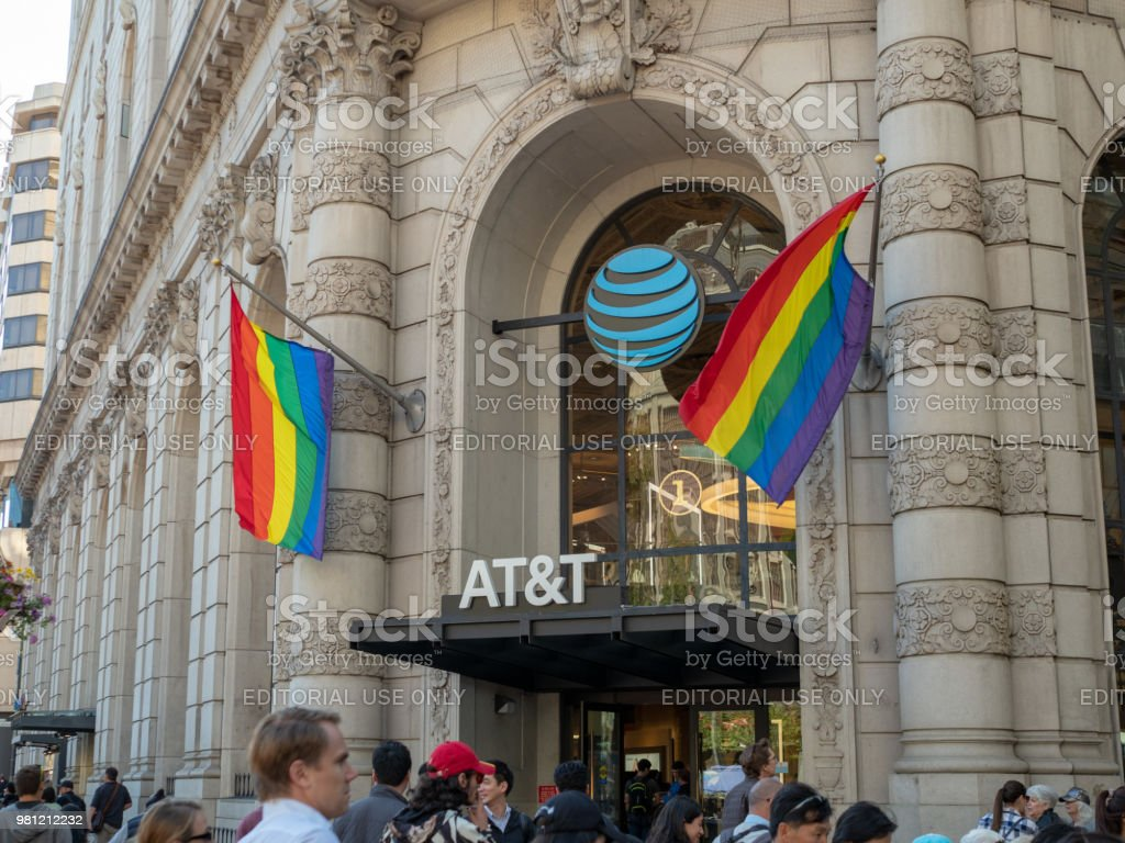 Gay Pride flags waving outside of an AT&T store location stock photo