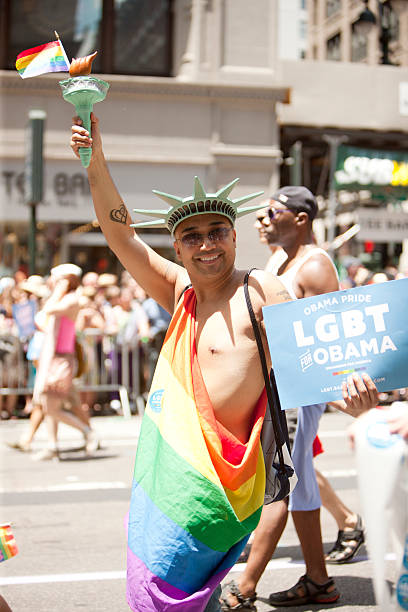 """Gay Pride """"New York City, USA - June 24, 2012: An event participant marching at the New York City Gay Pride Parade event on 5th ave."""" barack obama stock pictures, royalty-free photos & images"""