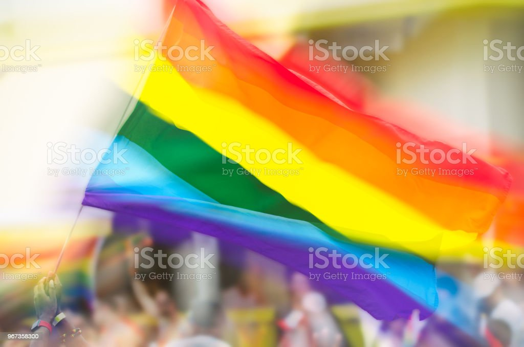 fa5cc02d1db8 Gay Pride Rainbow Flag Flying In Crowd Stock Photo   More Pictures ...