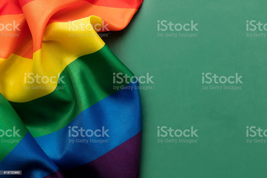 Gay pride rainbow flag on a chalkboard background stock photo