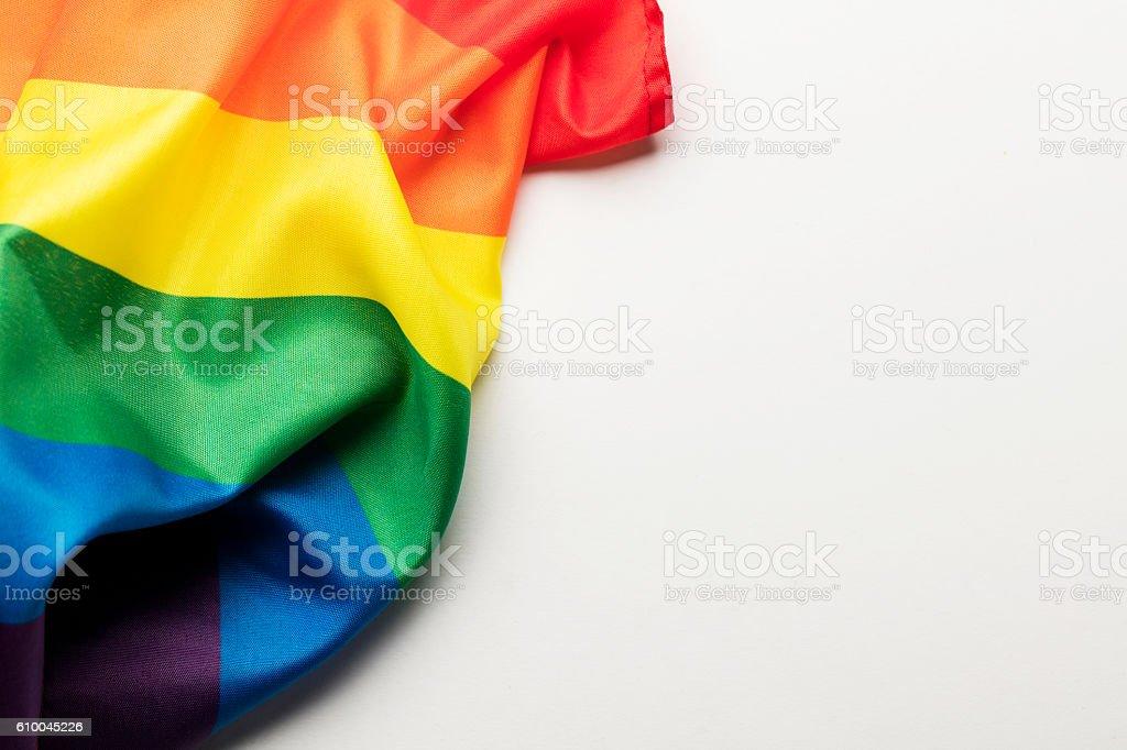 Gay pride rainbow flag on a plain background stock photo