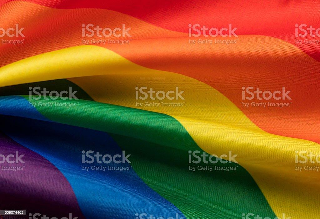 LGBT gay pride rainbow flag stock photo