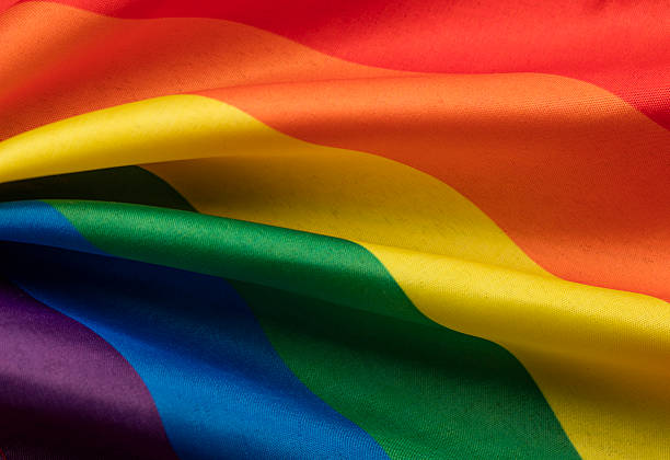 LGBT gay pride rainbow flag stock photo
