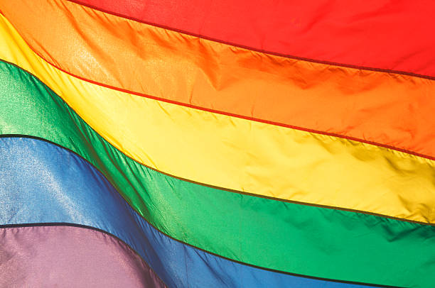 Gay Pride Rainbow Flag Shining in Bright Sunlight stock photo