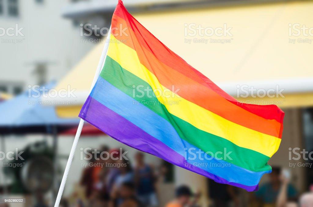 Gay Pride Rainbow Flag Waving on the Street stock photo