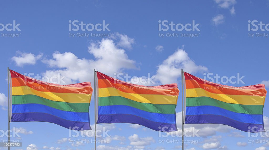 Gay Pride Rainbow Flags Blue Sky royalty-free stock photo