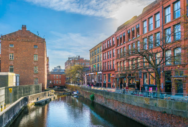 Gay village alongside Canal street in Manchester, England Manchester, UK, April 11, 2017: People are walking in the Gay village alongside Canal street in Manchester, England northwest england stock pictures, royalty-free photos & images