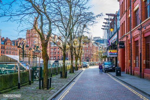 Manchester, UK, April 11, 2017: People are walking in the Gay village alongside Canal street in Manchester, England