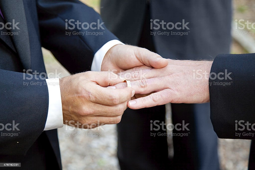 Gay Wedding - Exchanging Rings stock photo