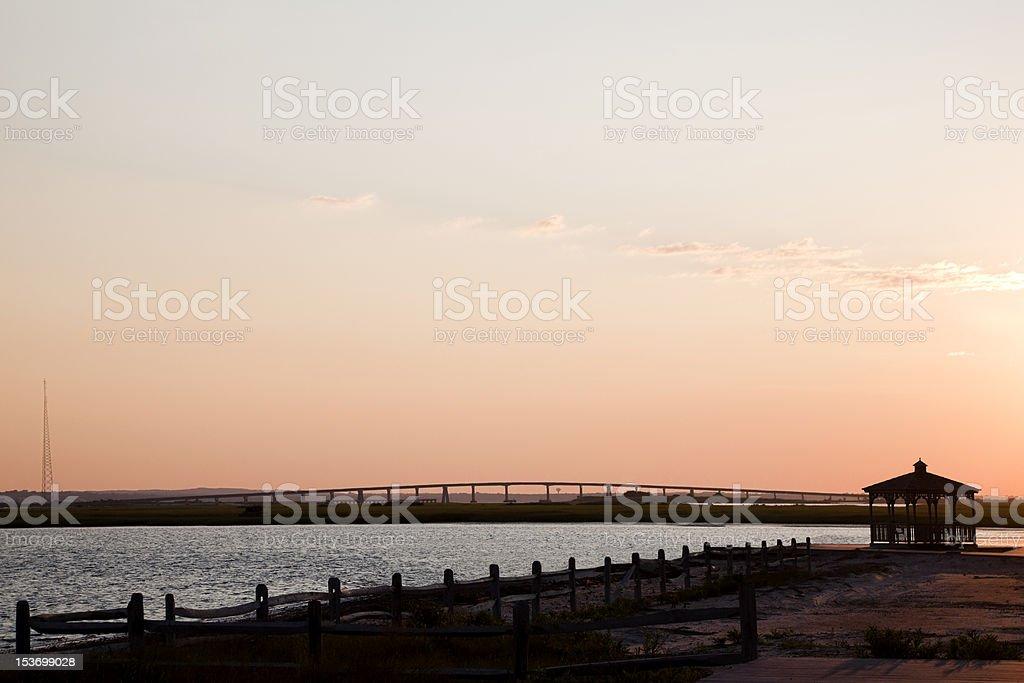 Gazebo and the Ponquogue Bridge at Sunrise. stock photo