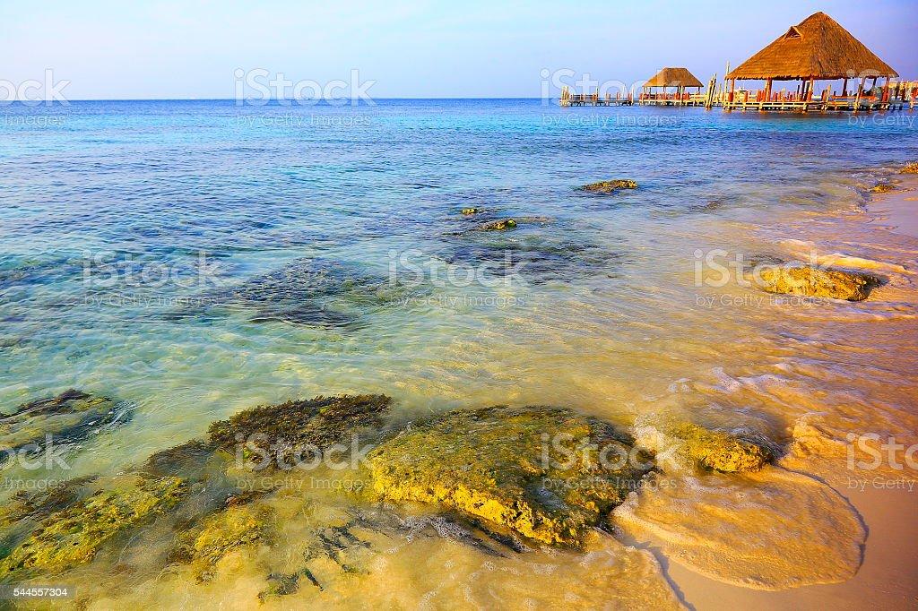 Gazebo / palapa - idyllic beach waves sunset - Cancun, Mexican caribbean stock photo