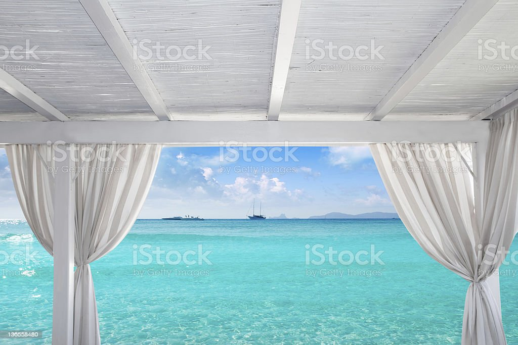 Gazebo white in Formentera Ibiza beach stock photo