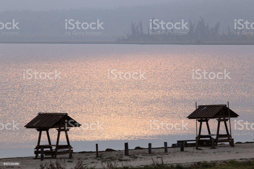 Gazebos on the lake against the sunlight. stock photo