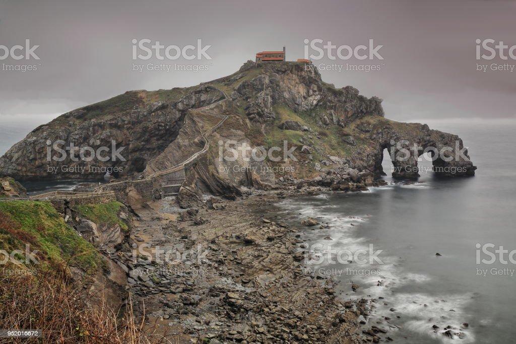 Gaztelugatxe islet with San Juan hermitage on top. Bermeo-Bizkaia-Biscay-Spain. 01 stock photo