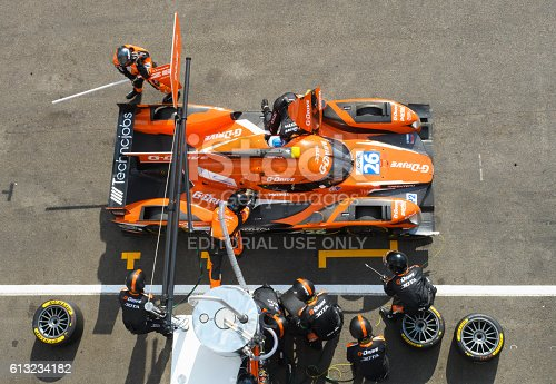 Spa, Belgium - May 7, 2016: Pit stop for the G-Drive Racing Oreca 05 - Nissan LMP2 race car during the Six Hours of Spa Francorchamps. Mechanics are re-fuelling the car and ready to change the tyres once fuelling has finished. The car is driving around the Spa Francorchamps race track during the WEC 6 Hours of Spa-Francorchamps. The team participates in the 2016 FIA World Endurance Championship (WEC).