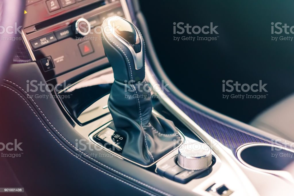 Gear stick with multimedia console stock photo