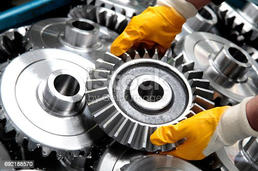istock Gear Wheel and Worker 692188570