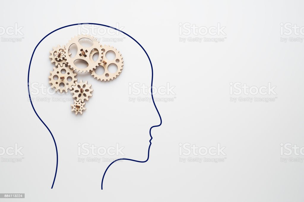 Gear wheel, human brain concept. Man with a gear mechanism in the head. stock photo