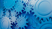 Gear wheels, industrial blue parts of engine. Abstract 3D illustration.