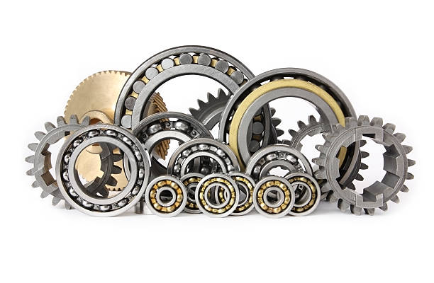 Gears and bearings on white background stock photo