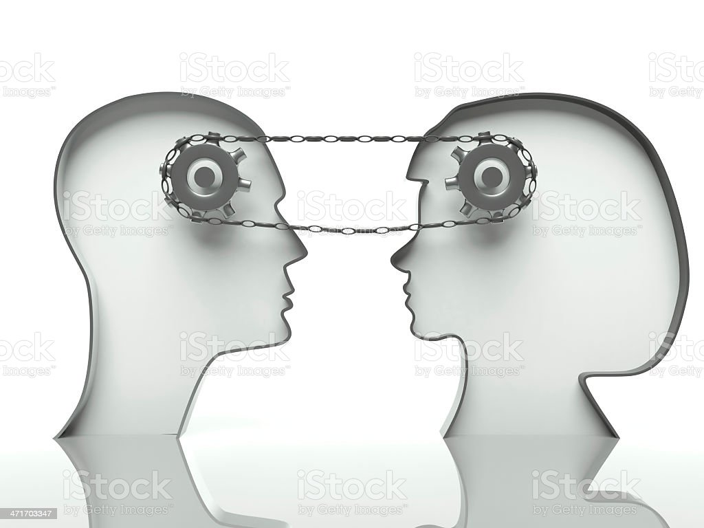 Gears and chain in heads, concept of teamwork with communication stock photo