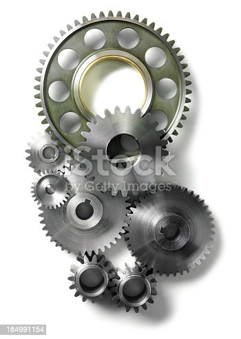 Engineering machine cogs and gears on a stainless steel background
