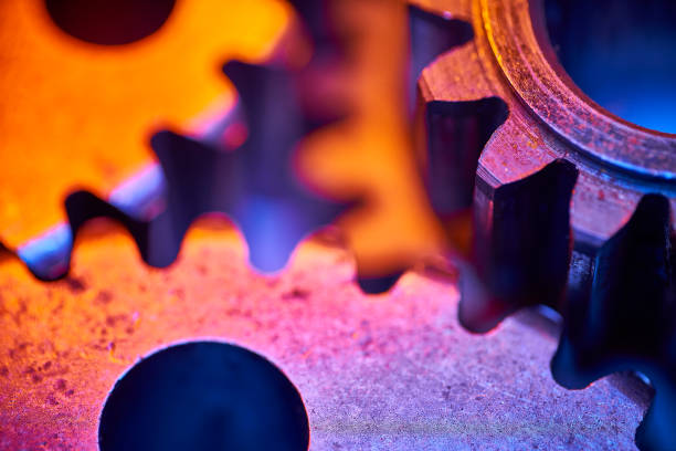 Gears: colorful, close-up, abstract concept for teamwork and unity stock photo
