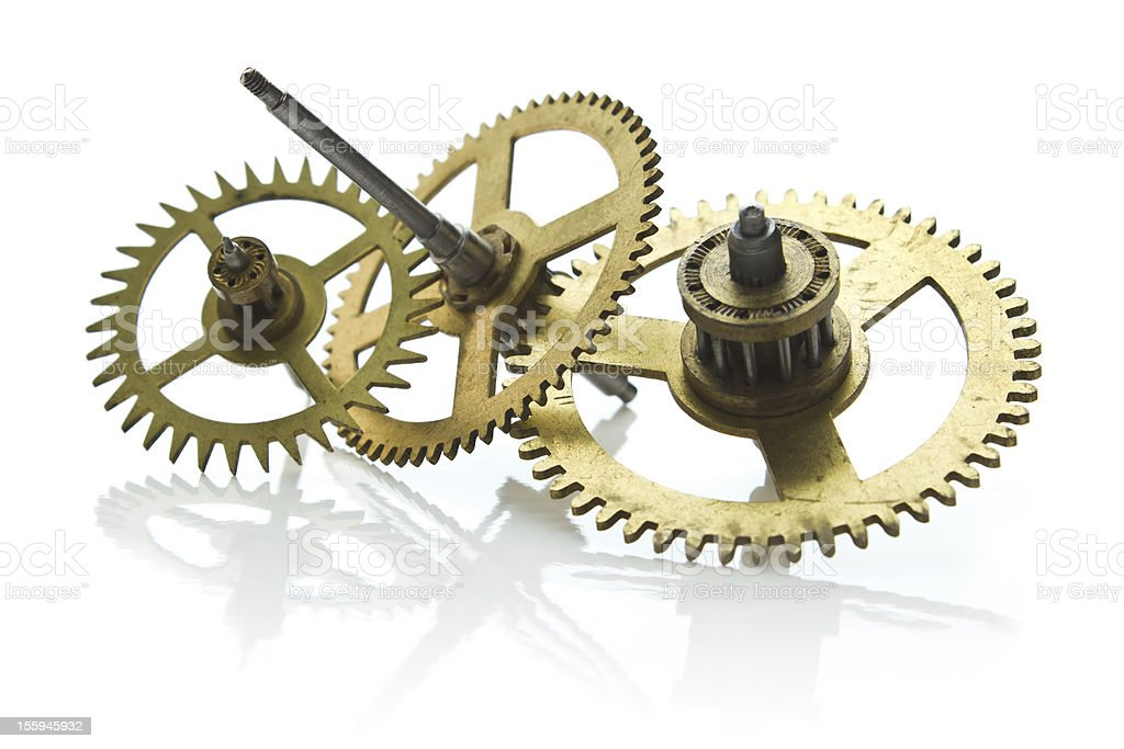 gears from old clock isolated on white background royalty-free stock photo