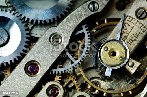 Clockworks inside an antique wristwatch showing cogs and rubies.