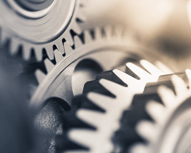 gears industrial background gears industrial background gearshift stock pictures, royalty-free photos & images