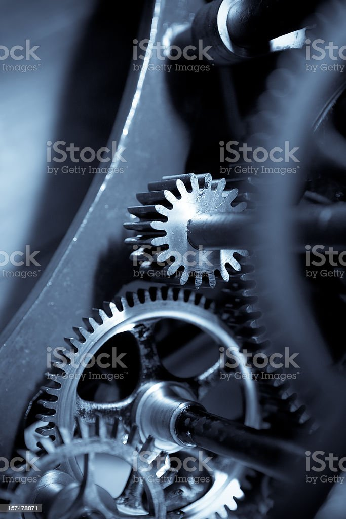 Gears inside a clock royalty-free stock photo