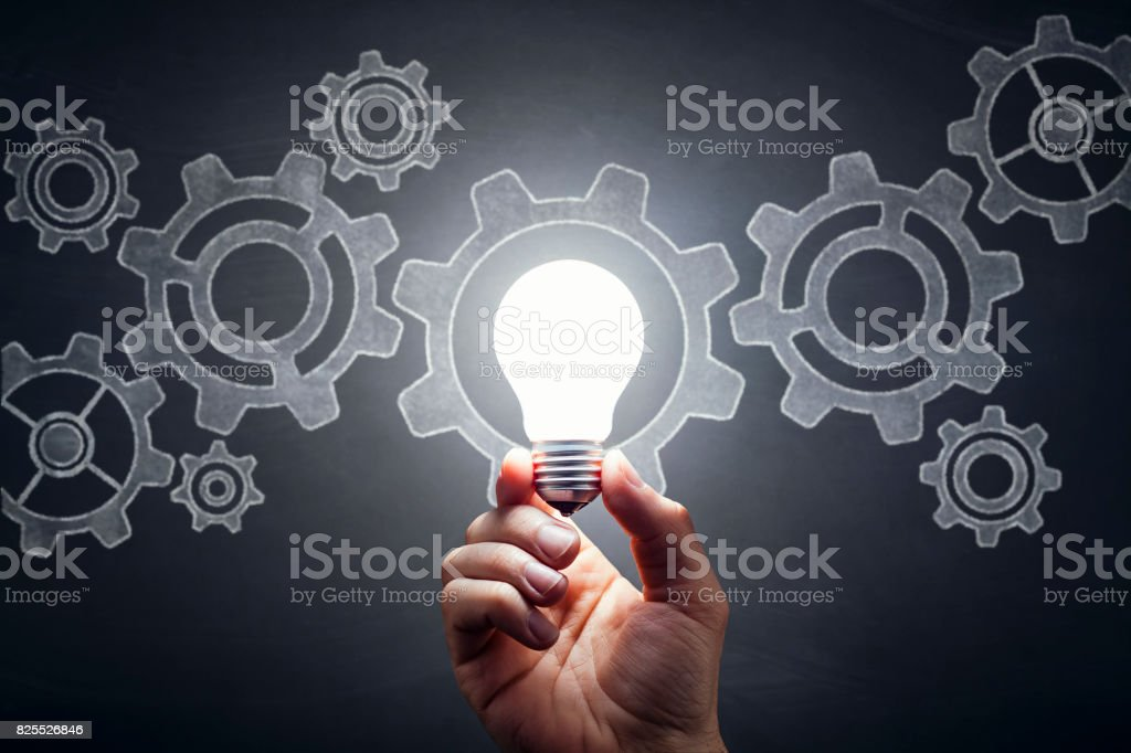 Gears - Light Bulb Hand Idea Blackboard stock photo