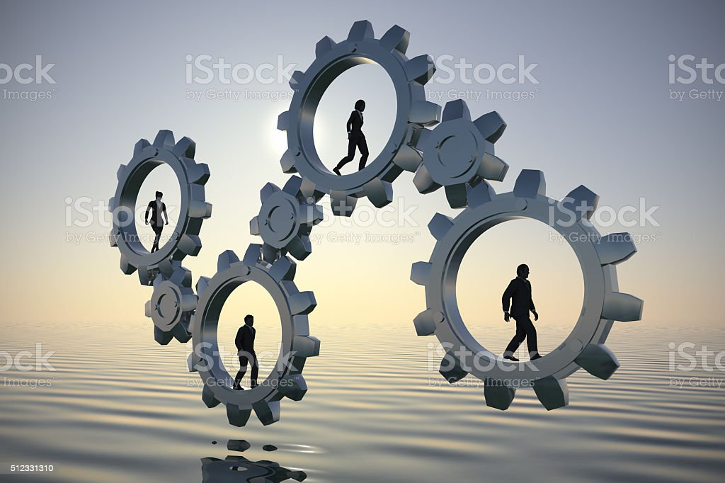 Gears of teamwork at sea at dawn stock photo