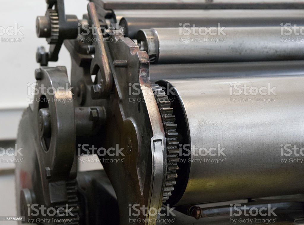 Gears of the old machine in a printing house stock photo