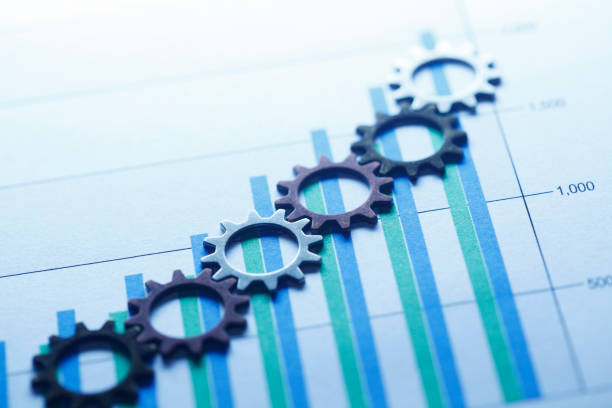 gears on a bar chart - business strategy stock pictures, royalty-free photos & images