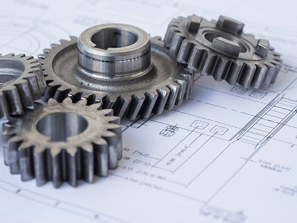 Gears on a project A group of gear on a project mechanical engineering stock pictures, royalty-free photos & images