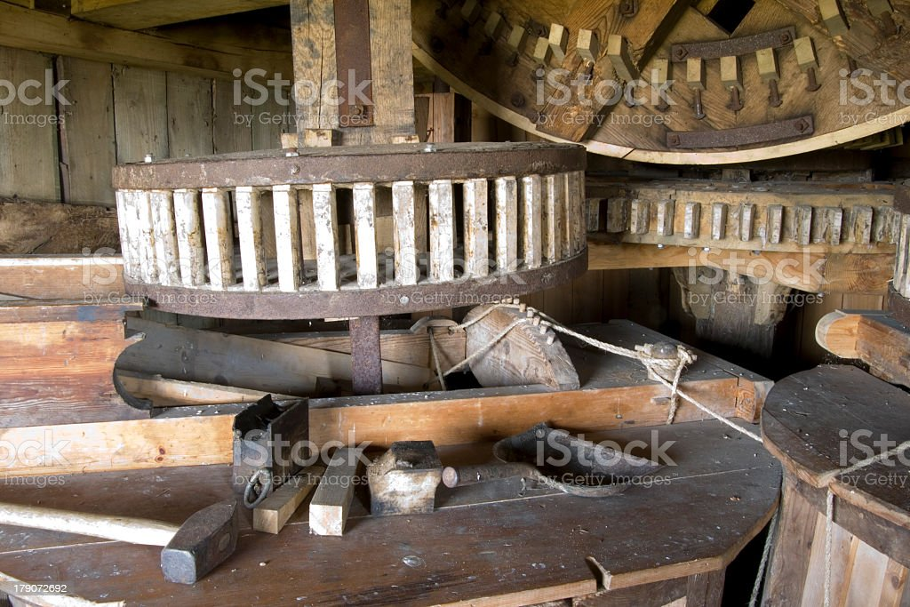Gear-wheel of traditional windmill mechanism royalty-free stock photo