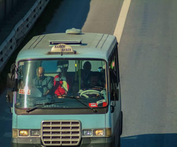 Istanbul, Turkey - November 10, 2009: Gebze - Harem Minibus on E-5 highway stock photo