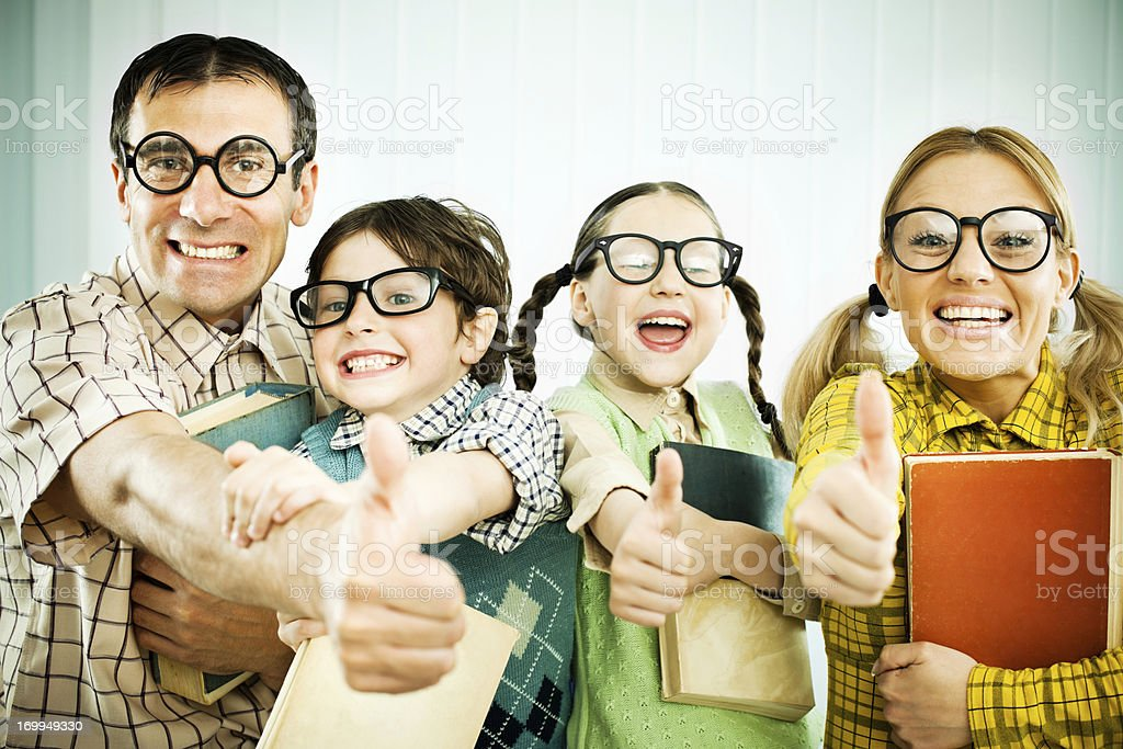 Geek family showing ok with their thumbs. stock photo