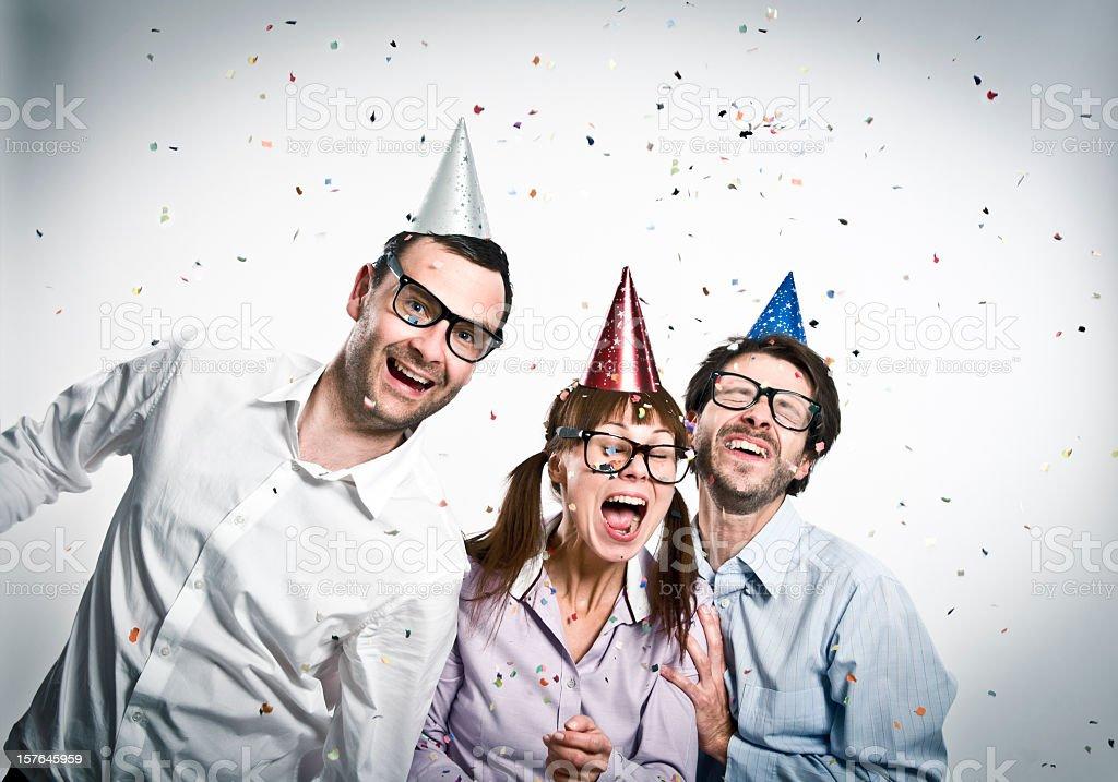 Geek friends at party, happy three nerd people, studio shot royalty-free stock photo